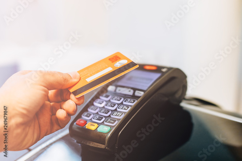 Photo Payment terminal charging from a card