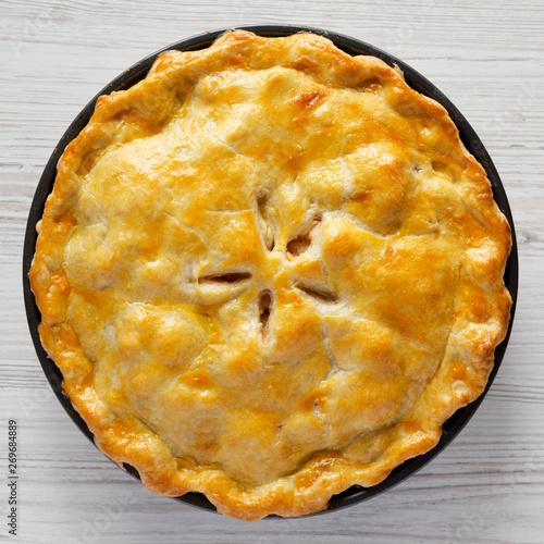 Fototapeta Homemade american apple pie dessert on a white wooden background, top view