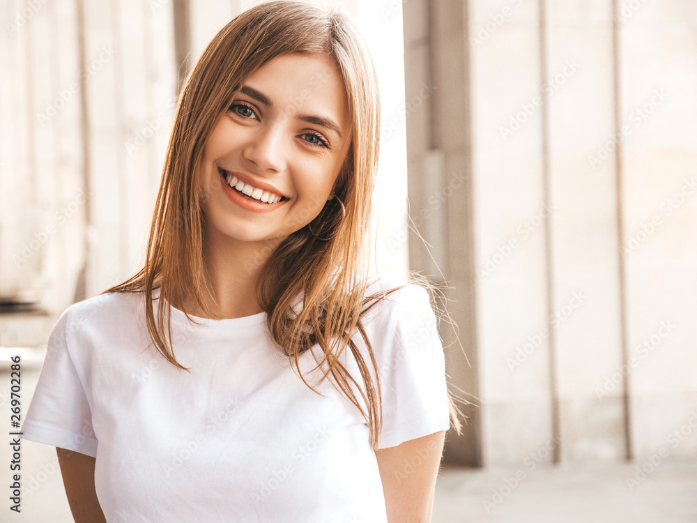 Fototapeta Portrait of beautiful smiling blond model dressed in summer hipster clothes. Trendy girl posing in the street background. Funny and positive woman having fun