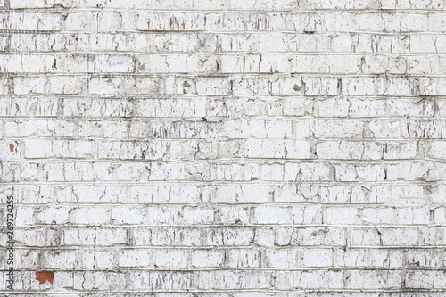 Fotografía  Old wall made of red brick, painted white in loft style for modern designer inte
