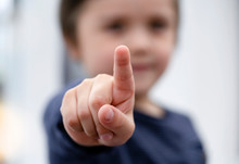 Blurry Face Of Little Boy Finger Pointing At Camera, Selective Focus Of Kid Primary School Boy Pointing To You With His Finger, Spoild Children Concept