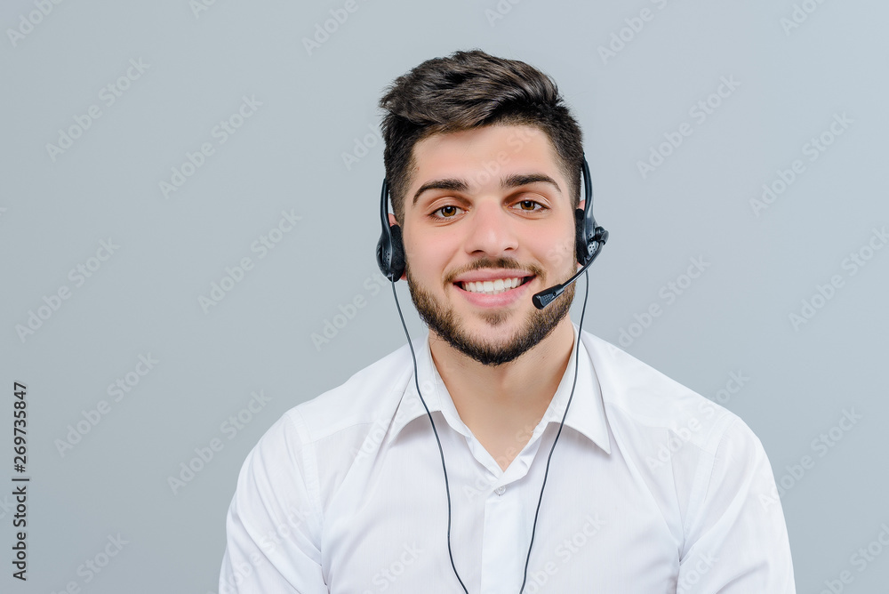 Fototapety, obrazy: Handsome middle eastern man working with headset answering business calls as tech support dispatcher isolated over grey background