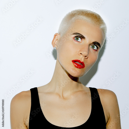 swag blonde girl with trendy short haircut tomboy style