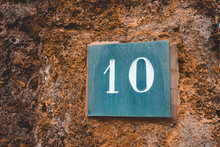 Number 10 Sign On Grey Marble Stone