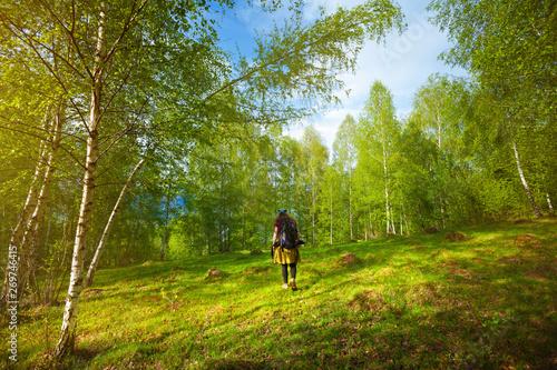 Acrylic Prints Horseback riding Girl travelling through beautiful epic mountain landscape