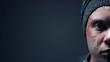 Leinwandbild Motiv Half-face of injured crying person on dark background, cruelty and violence