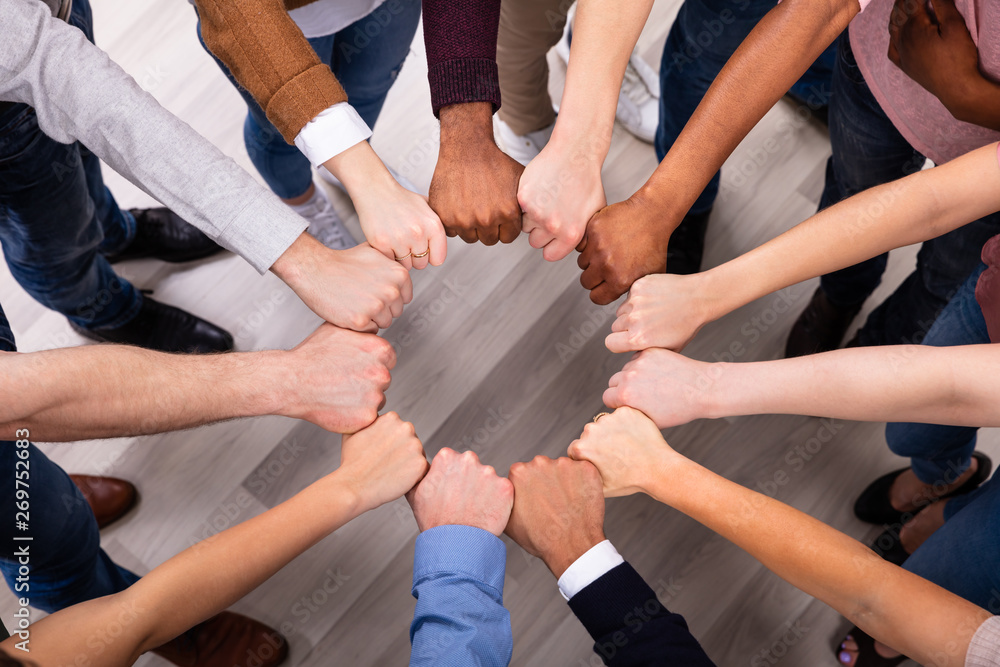 Fototapeta People Hands Joining Their Fist To Form Circle