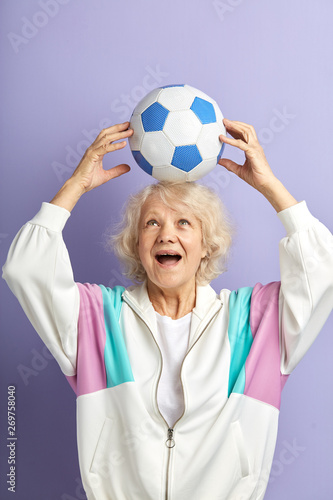 Jouful positive old lady supporting football team, sport betting, active life, age concept