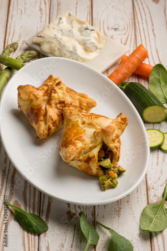 Fototapeta puff pastry filled with gorgonzola cheese asparagus zucchinis and carrots obraz