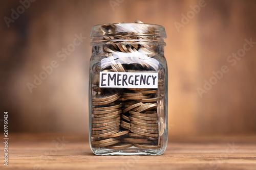 Emergency Label On Coins Jar Fototapeta