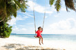Little Girl Swinging On The Beach