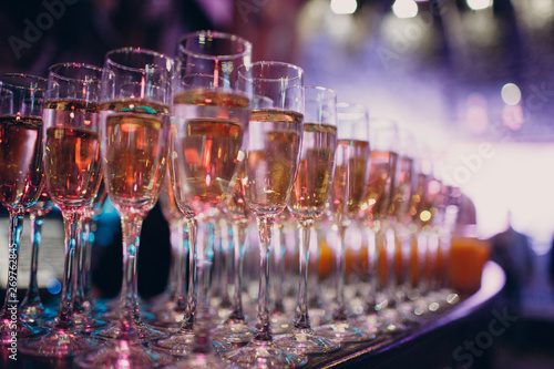 Glasses with champagne in a multi-colored light party