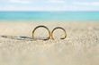 canvas print picture - Golden And Shiny Wedding Rings On Beach