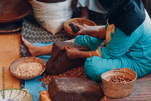 Woman making argan oil by hand craft Canvas Print