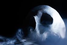 Human Skull In Smoke Profile View.