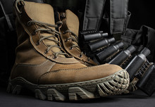 Photo Of A Pair Of Military Boots With Armor Vest.
