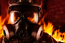 Warrior Soldier In Gas Mask In Fire Closeup.