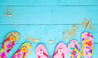 beach shoes with seashell and sand on wood background,Summer holiday concept