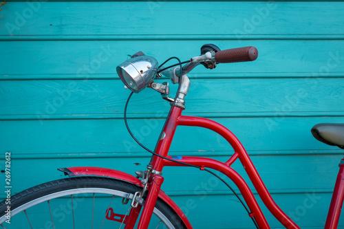 Türaufkleber Fahrrad red vintage bicyle parking on blue wooden wall