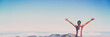 Leinwandbild Motiv Winning success banner woman reaching summit goal with arms up in the air panorama. Blue sky background. Girl living her life to the fullest fulfilling her dreams - bucket list concept.