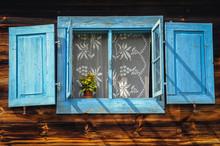 Blue Window Shutter Of Wooden Cottage In Poland