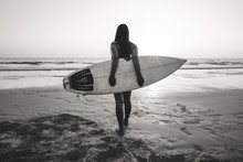 Nostalgia And Remembrance Photo Of Surfer Woman In Bikini Go To Surfing. Beautiful Sexy Woman With Surfboard On Beach. Black And White Color Tone.