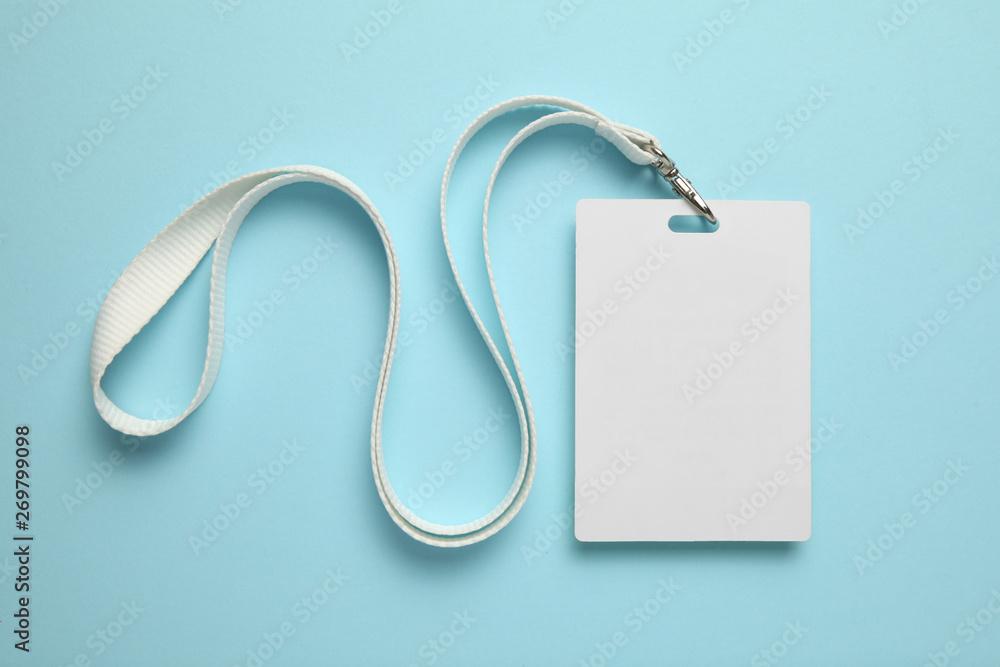 Fototapeta Name tag, badge mockup. Lanyard card blank on blue background.