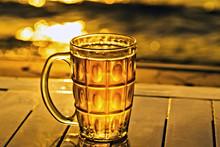 Glass Cold Mug Of Beer Beautiful Water Sunset
