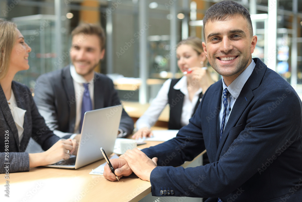 Fototapety, obrazy: Businessman with colleagues in the background in office.