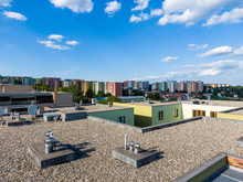 Aerial View Of House Flat Roof On Residental Building. Modern Architecture Exterior. Air Conditioning Systems And Ventilation Structure. Residental Building In Background, Sunny Day