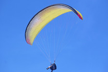 Tandem Paraglider Flying Yellow Wing