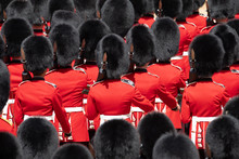 Close Up Of Soldiers Marching At The Trooping The Colour Military Parade At Horse Guards, London UK. Guards Are Wearing Iconic Black And Red Uniform And Bearskin Hats.