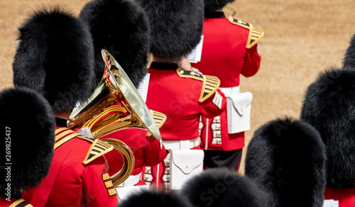 Papiers peints Rouge, noir, blanc Trooping the Colour, military parade at Horse Guards, London UK, with musicians from the massed bands. The ceremony is reflected in the brass of the instruments.