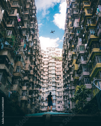 Photo  Man looking at airplane at Quarry Bay, Hong Kong.