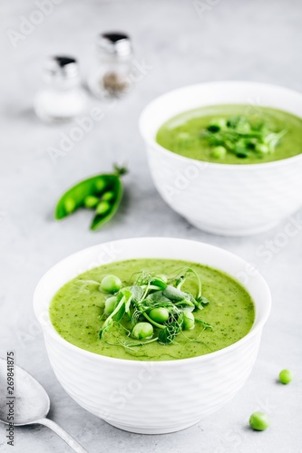 Cuadros en Lienzo Summer cream soup with green fresh pea shoots