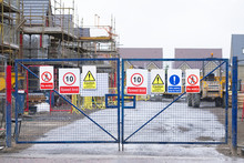 Construction Building Site Entrance Gate Fence And Health And Safety Signs