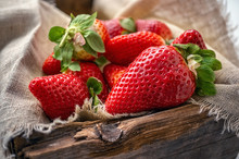 Beautiful Ripe Strawberries For Sale On A Tray In Wooden Containers. Without Plastic