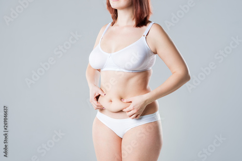 Woman with fat flabby belly, overweight female body on gray background Tapéta, Fotótapéta