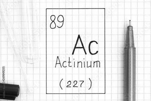 Handwriting chemical element Actinium Ac with black pen, test tube and pipette Canvas Print