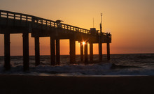 Sunrise At St. Augustine Beach Pier With Silhoutted Fisherman