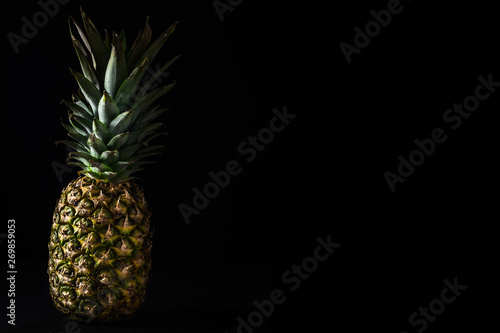 Fototapety, obrazy: Pineapple on black background.