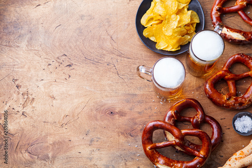 Beer, salted pretzels, potato chips Top view. Copy space