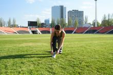 Beautiful Athletic Girl Tying Shoelaces At The Stadium