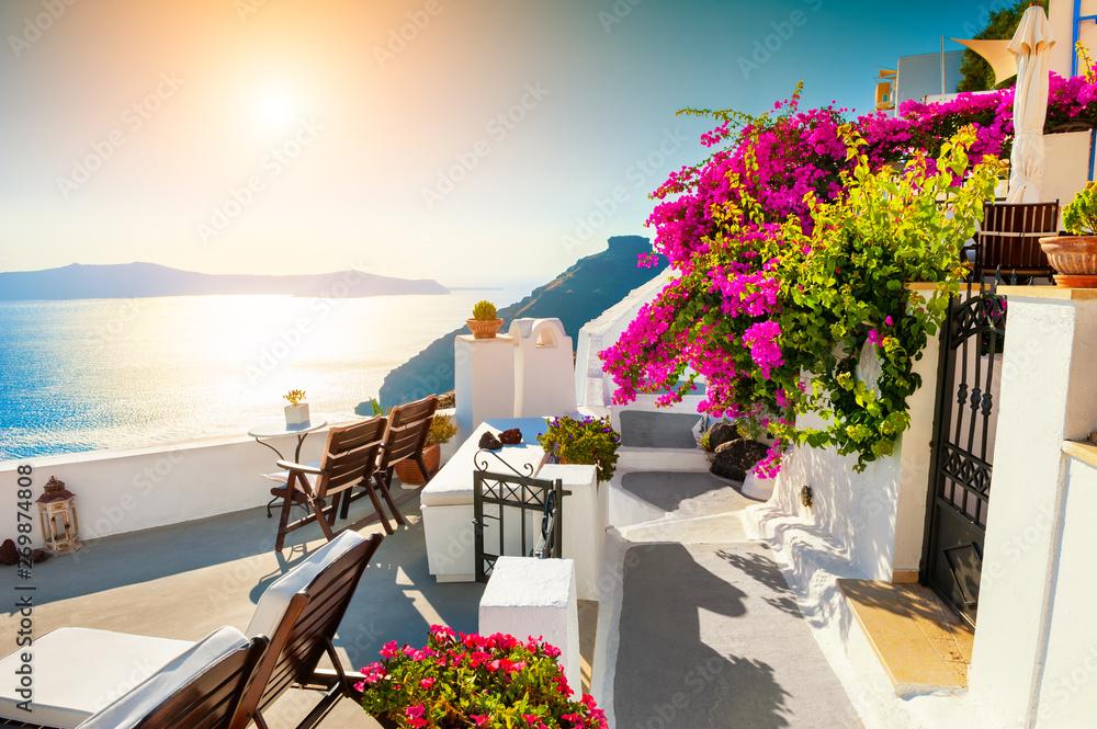 Fototapeta Beautiful sunset at Santorini island, Greece. Summer landscape with sea view. Famous travel destination