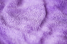 Lilac Delicate Soft Background Of Fur Plush Smooth Fabric. Texture Of Purple Soft Fleecy Blanket Textile