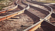 canvas print picture - A railway track litted by the sun, toned.