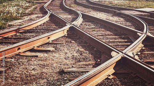 Foto A railway track litted by the sun, toned.