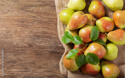 fresh pears on a wooden table, top view - 269884689
