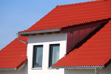 Dormer With Stainless Steel Cladding On A New Roof With Red Tiles