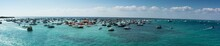 Panoramic View Of The  Crab Island Park In A Sunny Day With Several Small Boats In The Sea